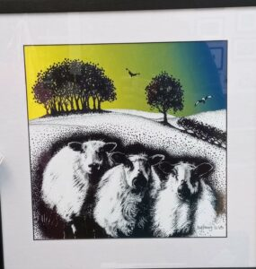 3 sheep on a hill